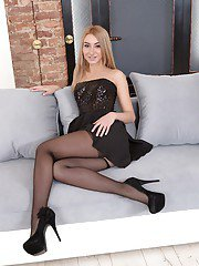 Clothed Euro model Tina Molly showing off great legs in black pantyhose