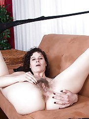 Mature woman Sunshine showing off hairy armpits in sexy black pantyhose