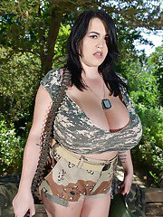 Chubby Euro chick Leanne Crow freeing massive tits from military outfit