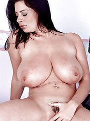 Hot Euro chick Linsey Dawn McKenzie exposing large natural juggs and bush