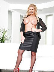 MILF pornstar Phoenix Marie flaunting large boobs in nylons and skirt