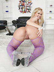 Mature blonde woman Ryan Conner showing off big butt in purple pantyhose