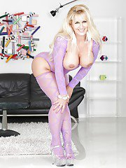 Blonde MILF flaunting big white ass in purple hose and high heels