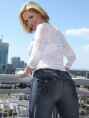 Blonde MILF Zoe Zale unveiling big boobs and bare butt outdoors on rooftop