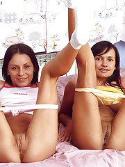 Young dyke Ann and girlfriend expose big natural boobs in panties and socks