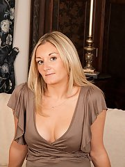 Blonde MILF Scarlet undressing while wearing high heels to bare big boobs