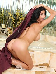 Wet brunette woman Alexis Fawx vaunting big fake tits in bath