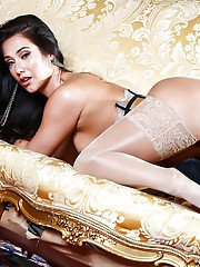 Mexican brunette Eva Lovia modeling in sexy stockings and lingerie