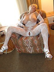 Older housewife Sandra Otterson releasing knockers from see thru stocking