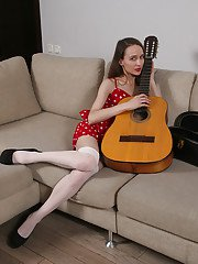 Thing older Latina Rose releasing hairy snatch from white lace panties