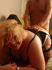 Fat mom Britany receiving cum on face after MMF threesome fuck