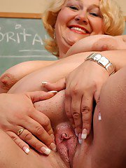Aged fatty Britany stripping off schoolgirl uniform in classroom