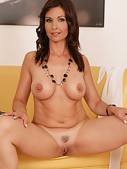 Brunette MILF Wendy stripping off blue jeans and white bra and panty set