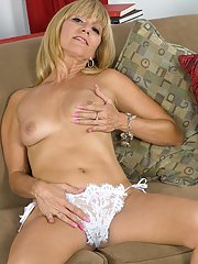 Blonde MILF model Jessica Sexxxton revealing tiny tits and shaved cunt
