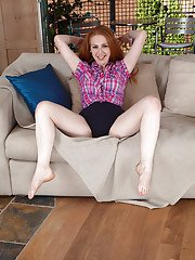 Older Welsh redhead Tia Jones frees really hairy pussy from shorts and undies