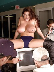 MILF Linsey Dawn McKenzie performing striptease at office party in long boots