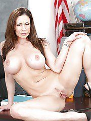 MILF pornstar Kendra Lust posing naked on teachers desk after shedding skirt