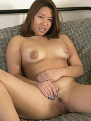 Barefoot Asian first timer Sandy stripping naked to display nice MILF pussy