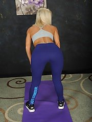 Blonde MILF Niki Lee Young stripping off yoga pants and lingerie on yoga matt