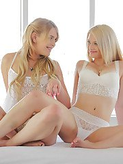 Teen lesbians Aubrey Gold and Abby Paradise tongue kiss after lingerie removal