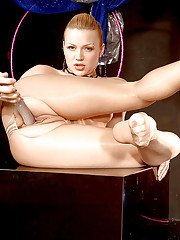 Leggy solo girl Katerina Kat freeing hose clad feet from high heels