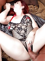 Older redhead plumper Heather Barron giving head before double penetration