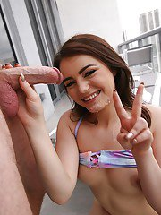 Young brunette Kylie Quinn giving ball licking blowjob on balcony