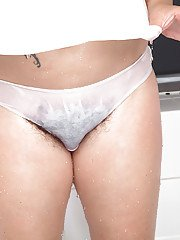 Older Euro lady Elle Macqueen freeing hairy cooter from cotton panties