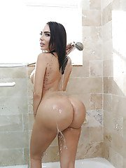 Latina model Lela Star wetting large boobs and big booty in shower