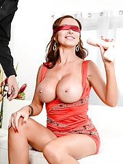Busty MILF Nikki Benz masturbating in high heels with blindfold on