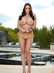 Brunette MILF Angela White covering huge tits in chocolate sauce on patio