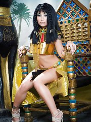 Brunette coed Rina Ellis peeling off Cleopatra themed cosplay outfit