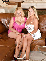 European lesbians Dolly Fox and Katie Thornton press hooters together