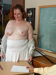 Freckle faced fatty Adrienne giving oral sex to teacher in classroom