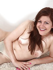 Older solo model Lacey undressing to show off her hairy vagina