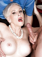 Mature woman with tattoo on her back Kimber Phoenix is shared by two males