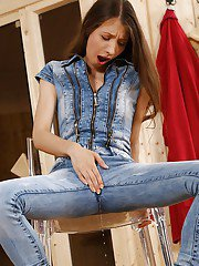 Stefany licks her piss-drenched jeans and stuffs cunt with red sex toy