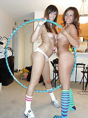 Nude teen dykes Holly Michaels and Stephanie Moretti having fun with hula hoop