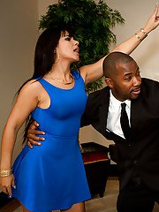 Brunette in blue skirt Rose Monroe takes black cock in mouth and in bald cunt