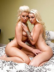 Blonde lesbian with tattooed arm Anikka Albrite fingers and licks Stevie Shae