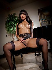 Latina solo model Rose Monroe revealing big booty in black nylons and heels