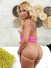Latin babe in pink top and blue skirt Nicki Woods shows off her plump booty