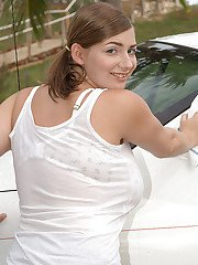 Solo girl Christy Marks wetting and soaping hooters while washing car on lawn