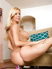Leggy pornstar Alexis Fawx unveiling big fake tits before baring of naked cunt