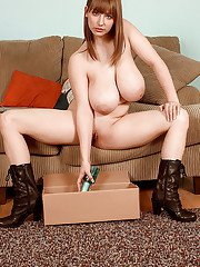 Busty chick Christy Marks opens parcels and masturbates with new sex toy