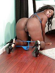 Black solo girl Coco Isis letting big booty loose before parting pink vagina