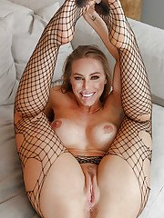 Trailer trash attired Nicole Aniston taking jizz on face in ripped stockings