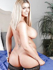 Blonde in black lingerie Brooklyn Chase reveals her big tits and perfect ass