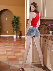 Young amateur teen Blaire Ivory shpws off naked in the kitchen