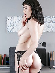 Brunette office babe Olive removes dress to pose shaved pussy and ass